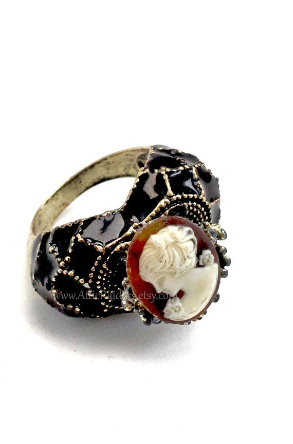 Black Cameo Steampunk Ring by AtticRaiders on Etsy  Same artist who made custom wand sheath