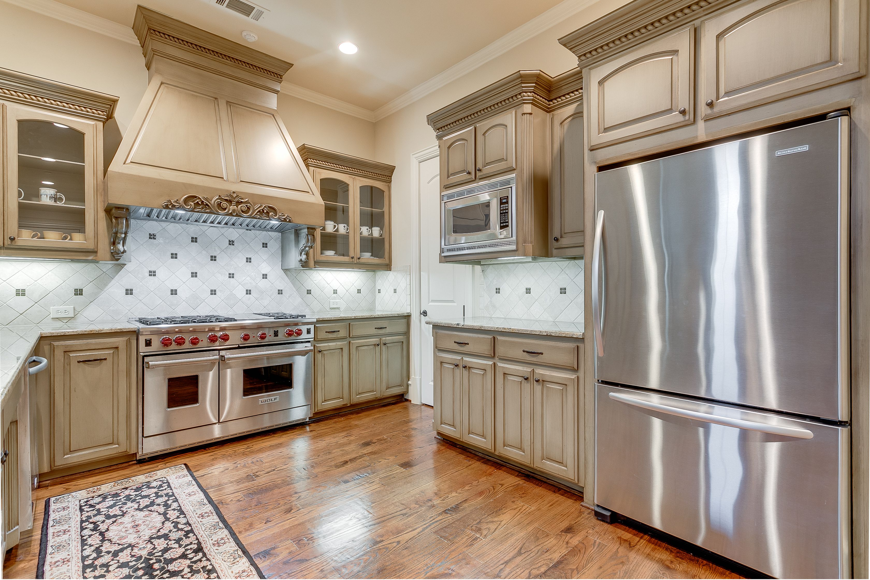 Kitchen Has Stainless Appliances Like New 6 Burner Gas Range With Grill Granite Countertops And Beautiful Custo Kitchen Custom Cabinetry Dallas Real Estate