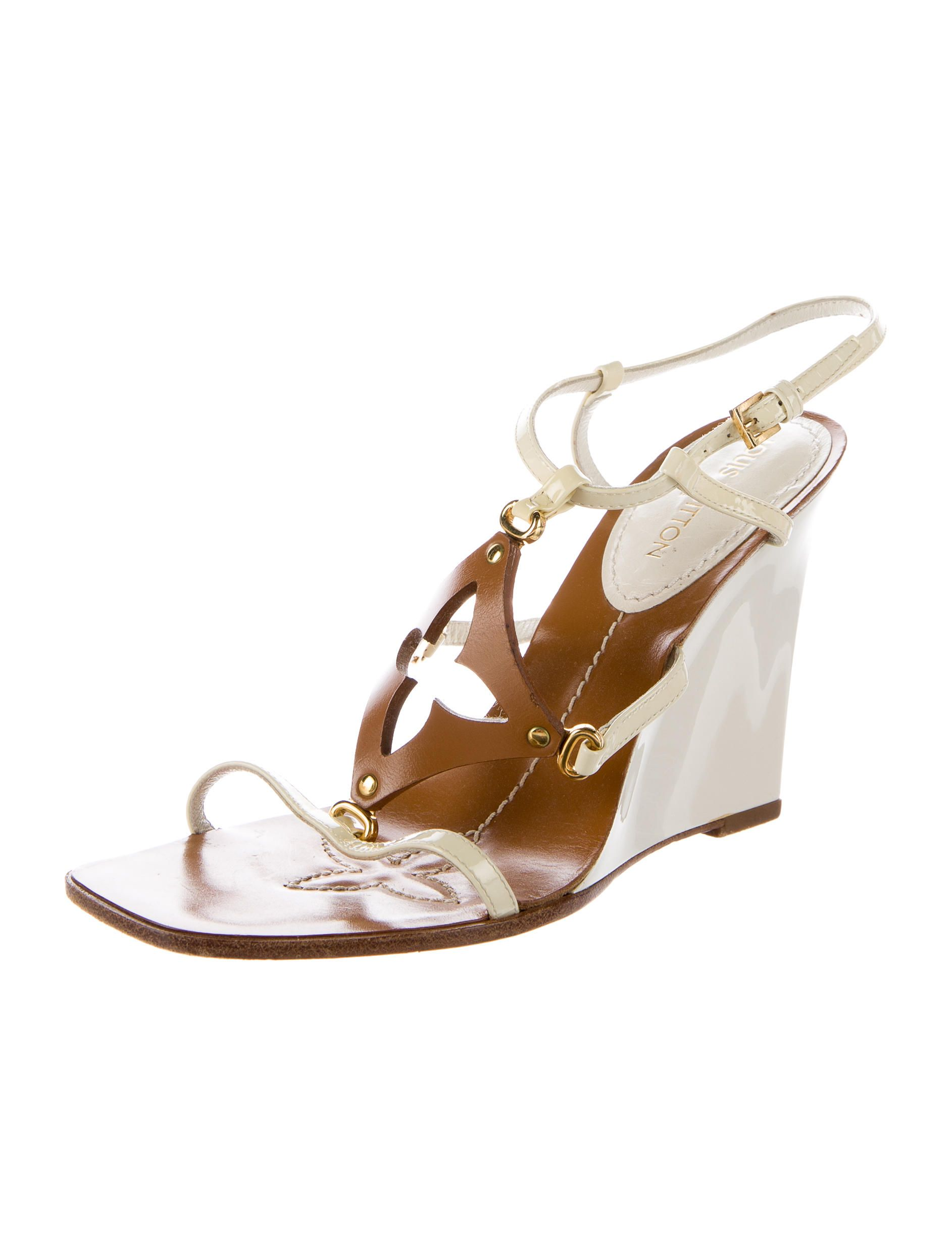 5a418f4eb4f0 White patent leather Louis Vuitton wedge sandals with gold-tone hardware