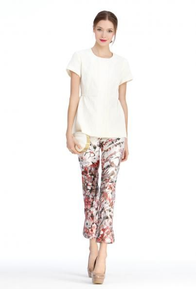 Ivory brocade gathered peplum jacket with floral print pencil pants and shell clutch by Charlotte Brody
