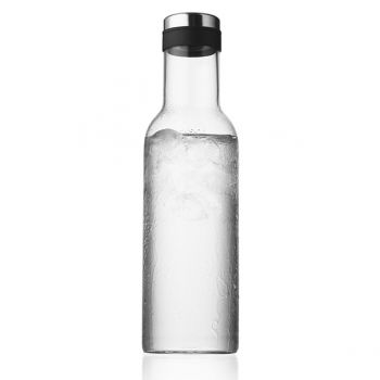 The clear, bottle-shaped New Norm Glass Carafe fits perfectly in the refrigerator door and it comes with a lid to prevent the water from absorbing odours from the refrigerator.