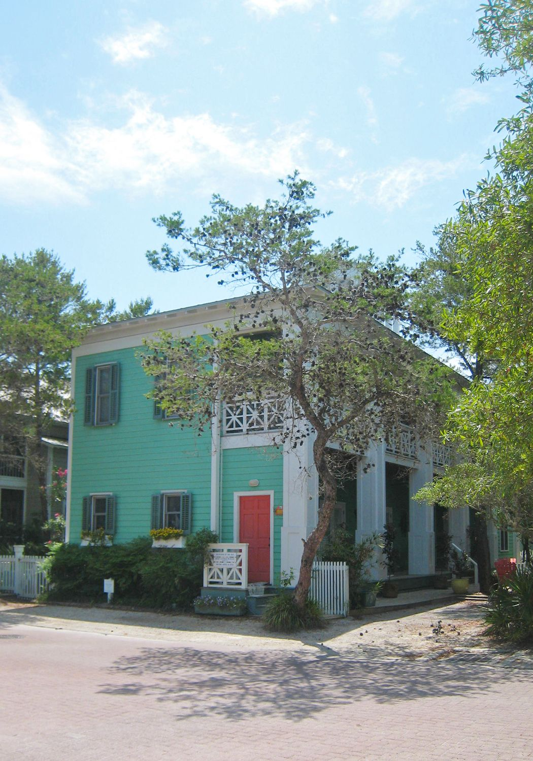 mint sea green house with coral red