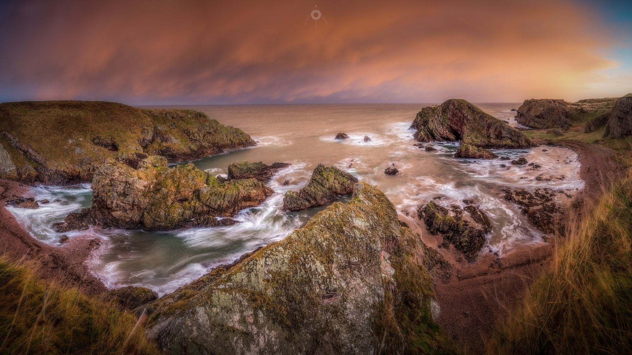 Stormy Sunrise - A stitched, panoramic, long exposure, landscape image of storm clouds over the Moray Firth, taken from Portknockie in Scotland, at sunrise.