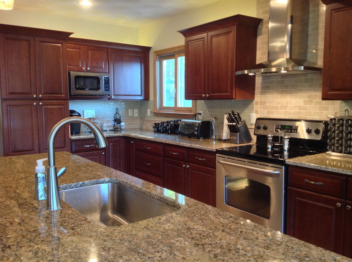 A Kitchen Remodel In Exeter Rhode Island Went From Small And Dated To Spacious And Timeless Lora Carmadell Brown Kitchens Kitchen Remodel Distressed Cabinets