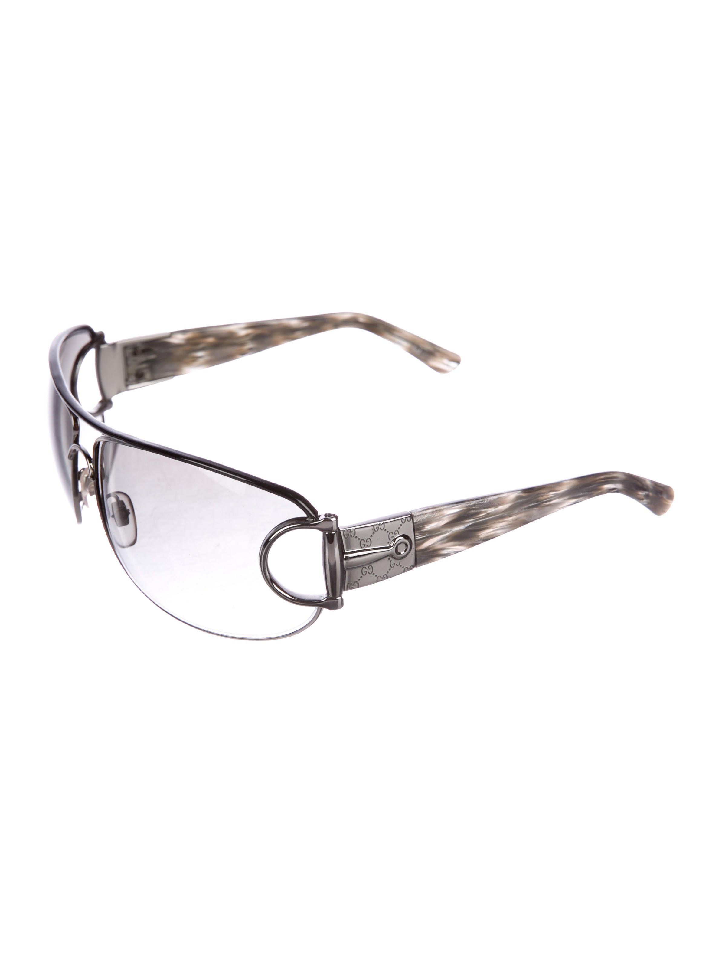 dd31e35ae7 Silver-tone metal Gucci sunglasses with charcoal gradient lenses at  oversize square frames and silver-tone GG-engraved embellishments at hinges  and temples.