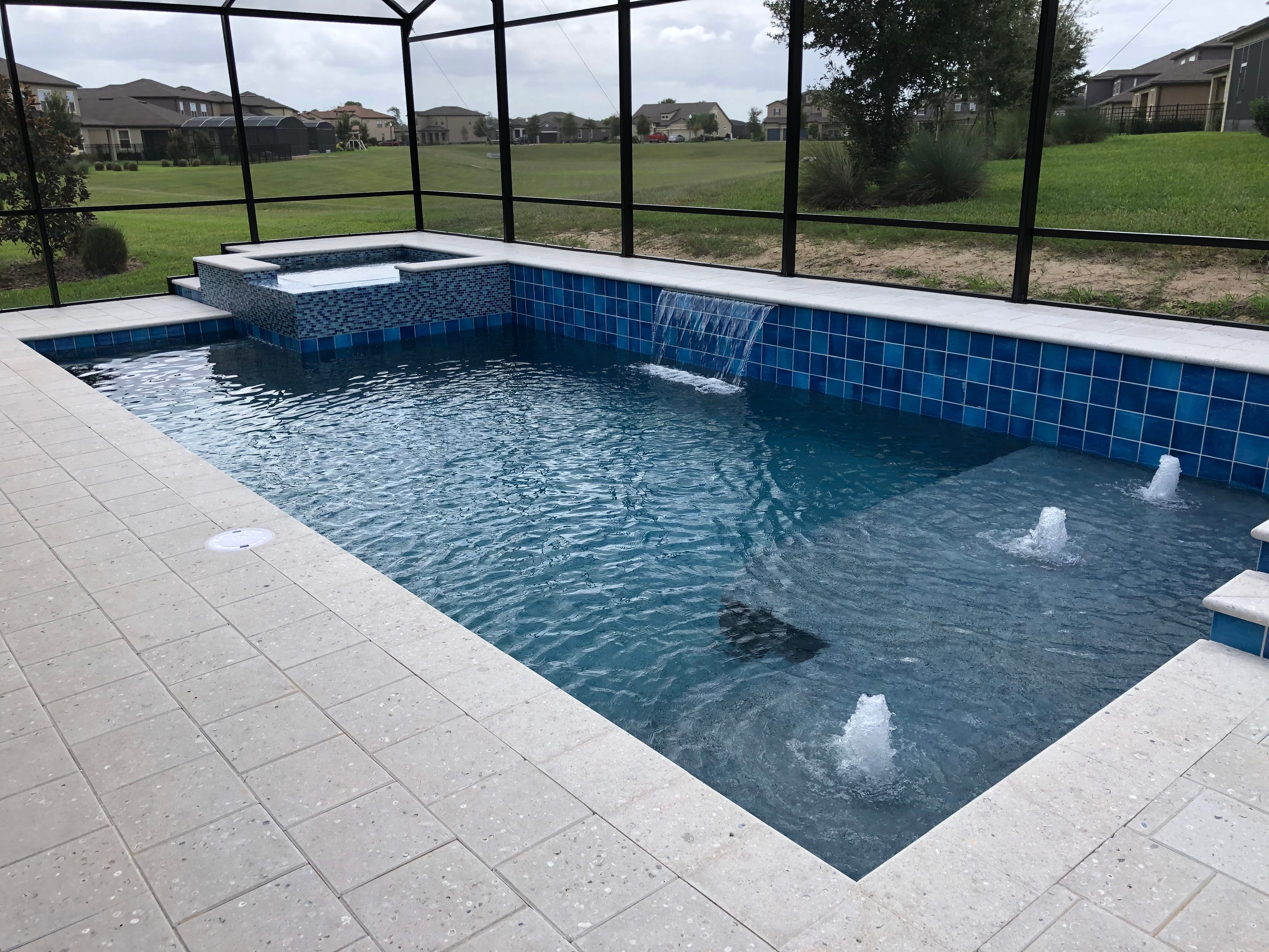 Swimming Pool and Spa with Tanning Ledge and Water Features