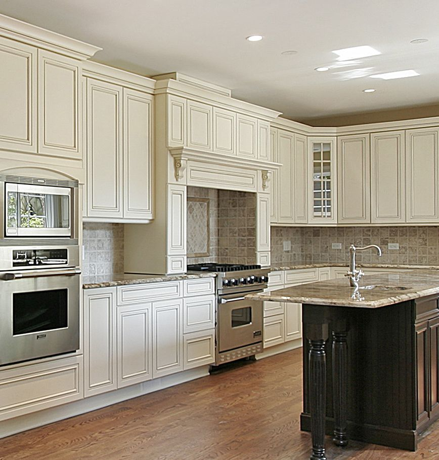 Off White Kitchen With Large Decorative Wood Hood Wall Oven Island Kitchen Ideas Condo Kitchen Kitchen Design New Kitchen Cabinets