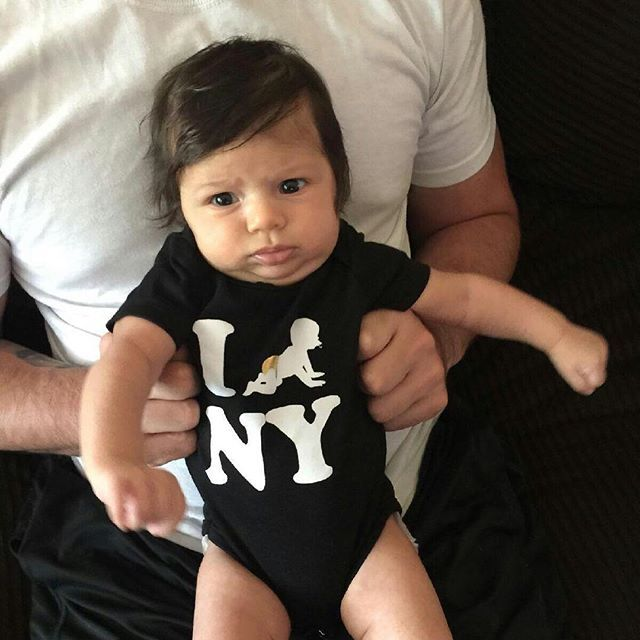 Welcome to New York, where we don't play Don't mess with little Miss Ava Rose. #meanmugging //Click on Big City Babies to get yours!emoji #icrawl #newyork #perfectlybaked #onesie #NY