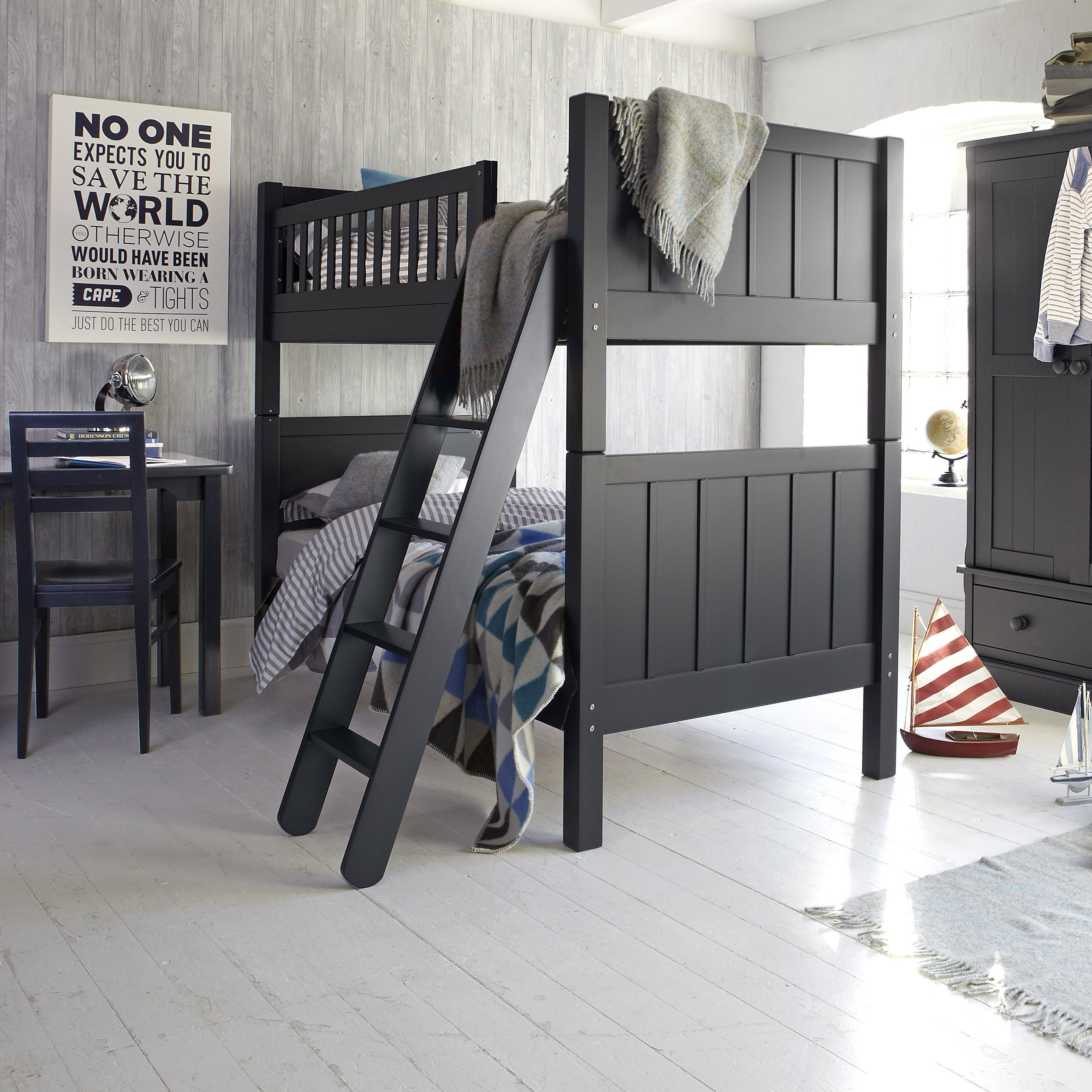 Classic Black Wooden Aspace Bunk Bed with Tilt Style Wooden Stairs and Blue  Triangle Pattern Bedding. Classic Black Wooden Aspace Bunk Bed with Tilt Style Wooden Stairs