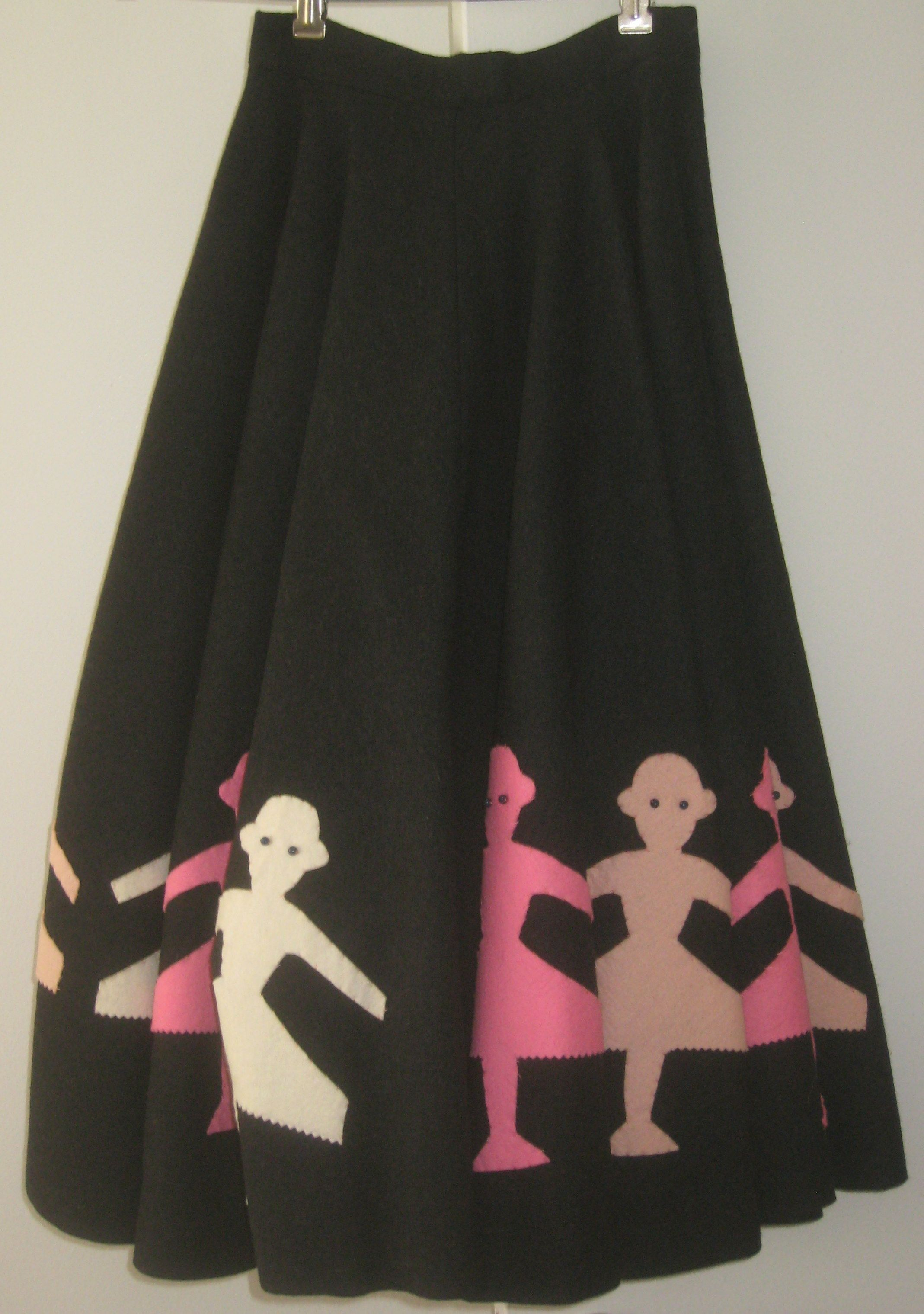 Vintage handmade skirt with applique figures