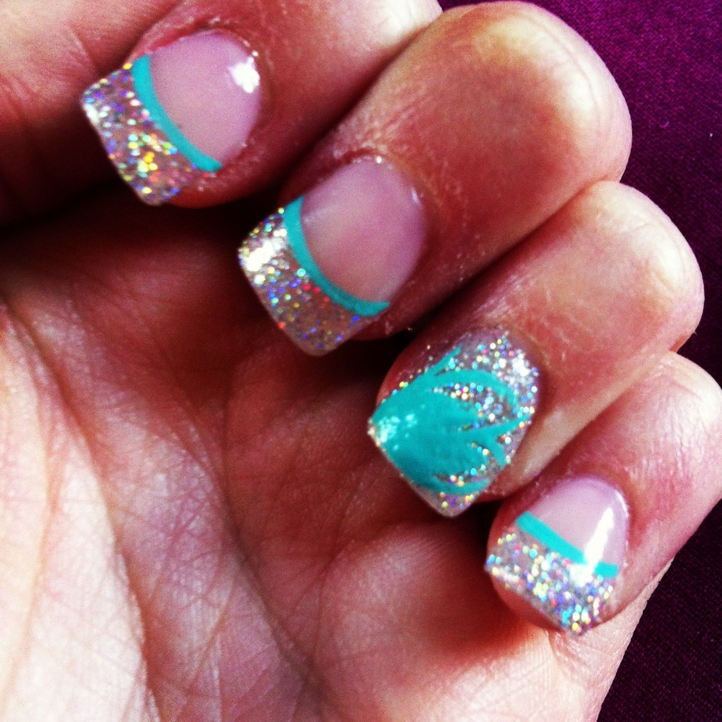 Prom mails! Silver sparkles tip with teal design (: acrylic nails ...