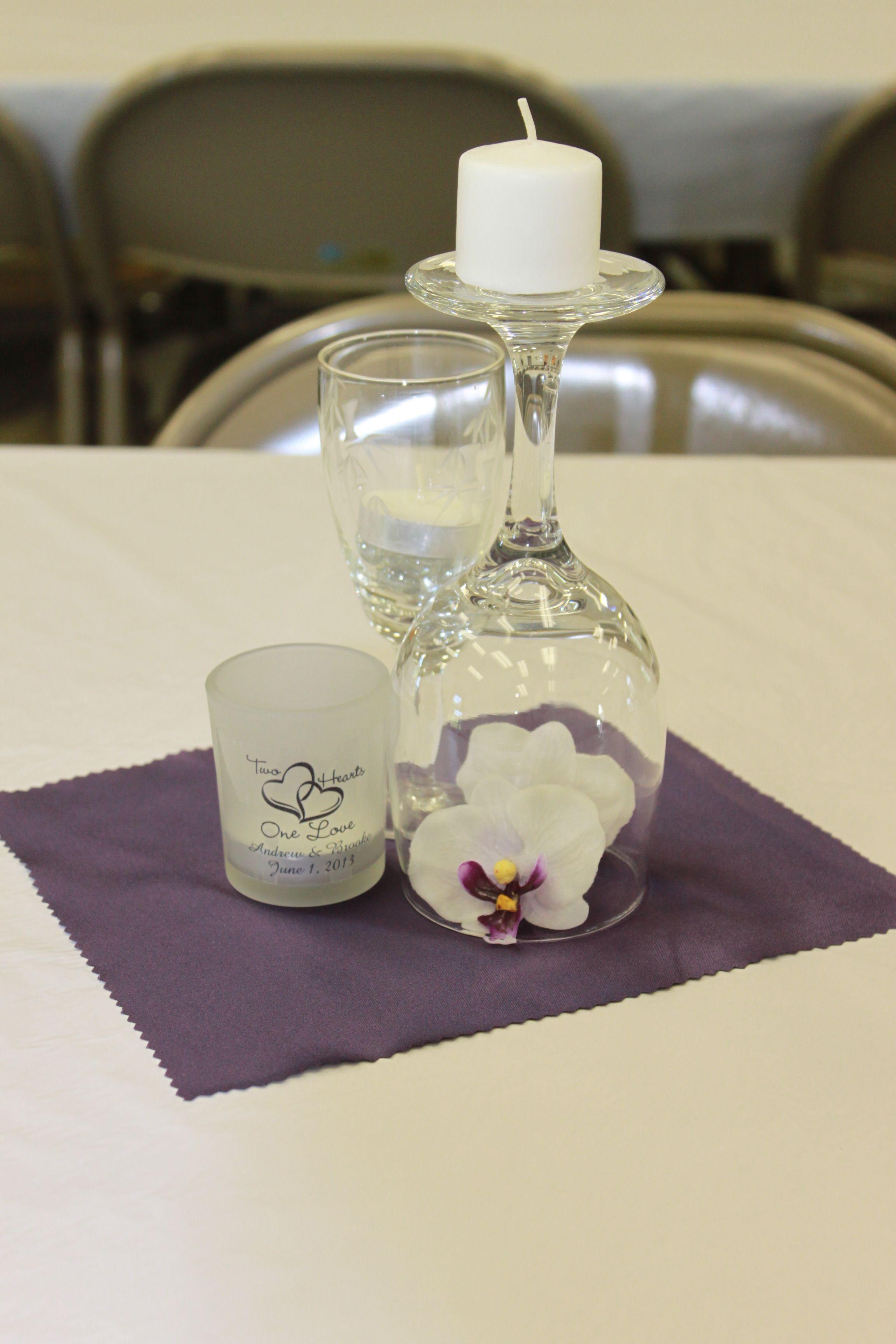 a centerpiece for a wedding...I got the upside down wine glass idea ...
