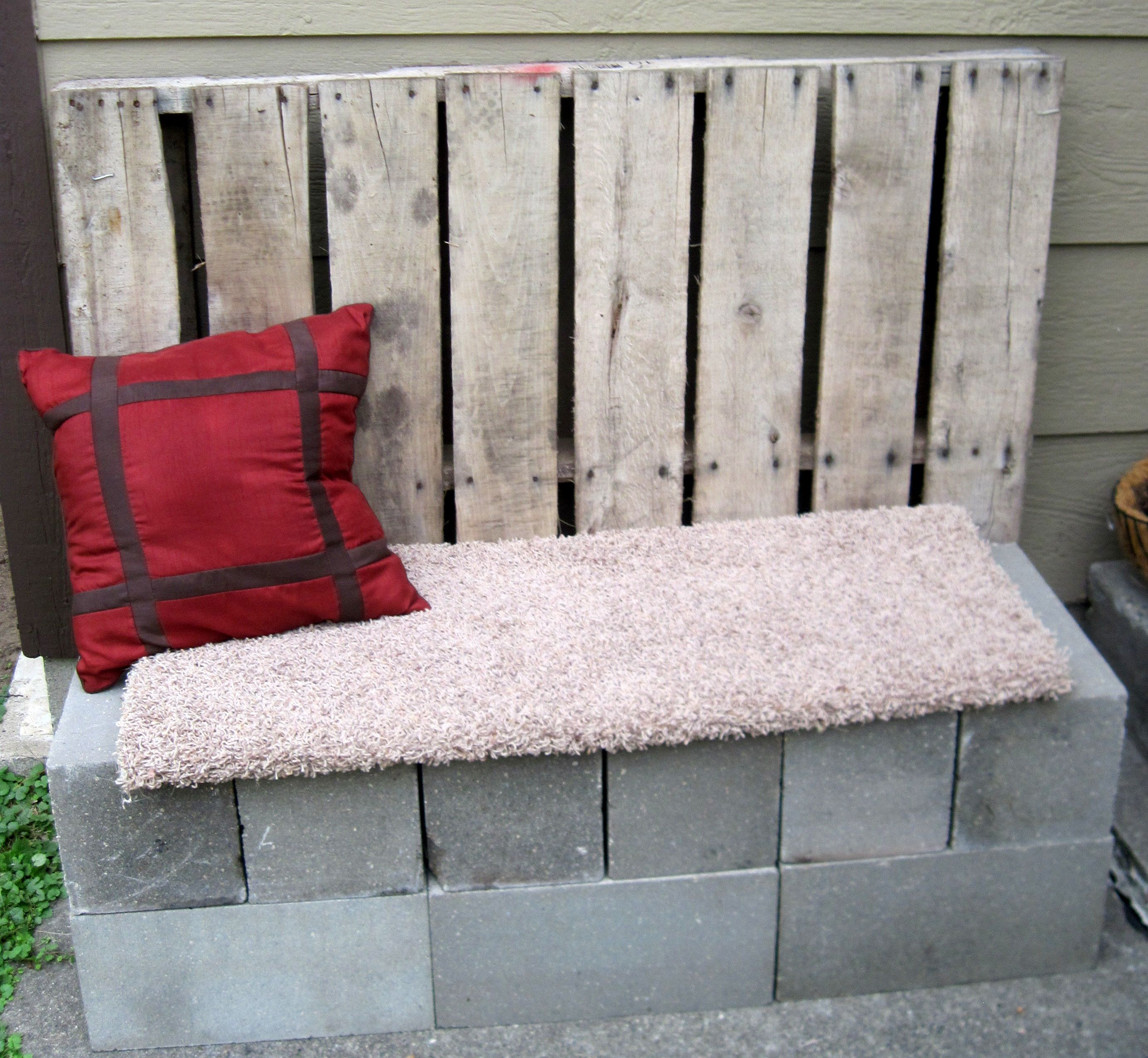 Cement Blocks Wood Pallet And An Old Carpet Remnant