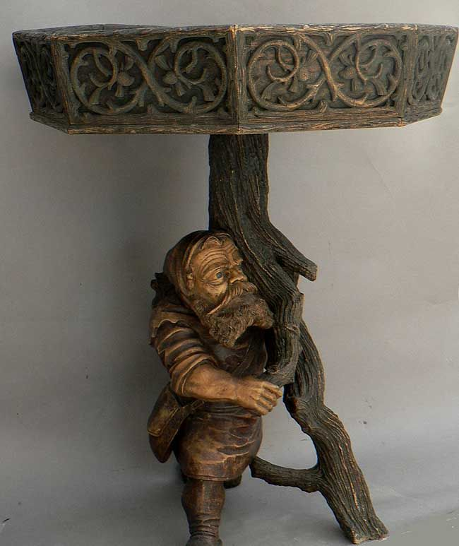 A Black Forest Carved Wood Dwarf Plant Stand Realm Of