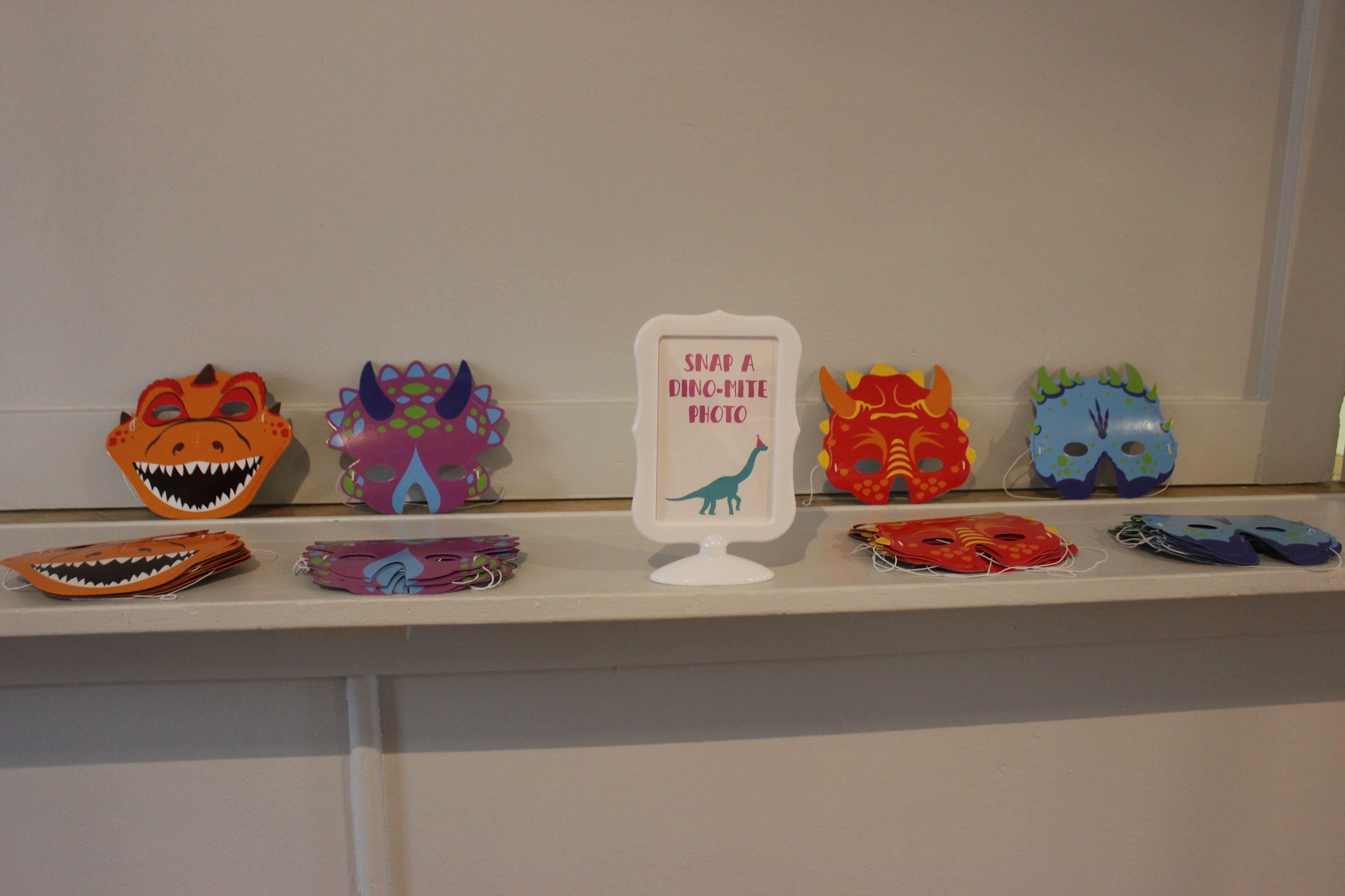 Dinosaur birthday party photo booth idea with face masks