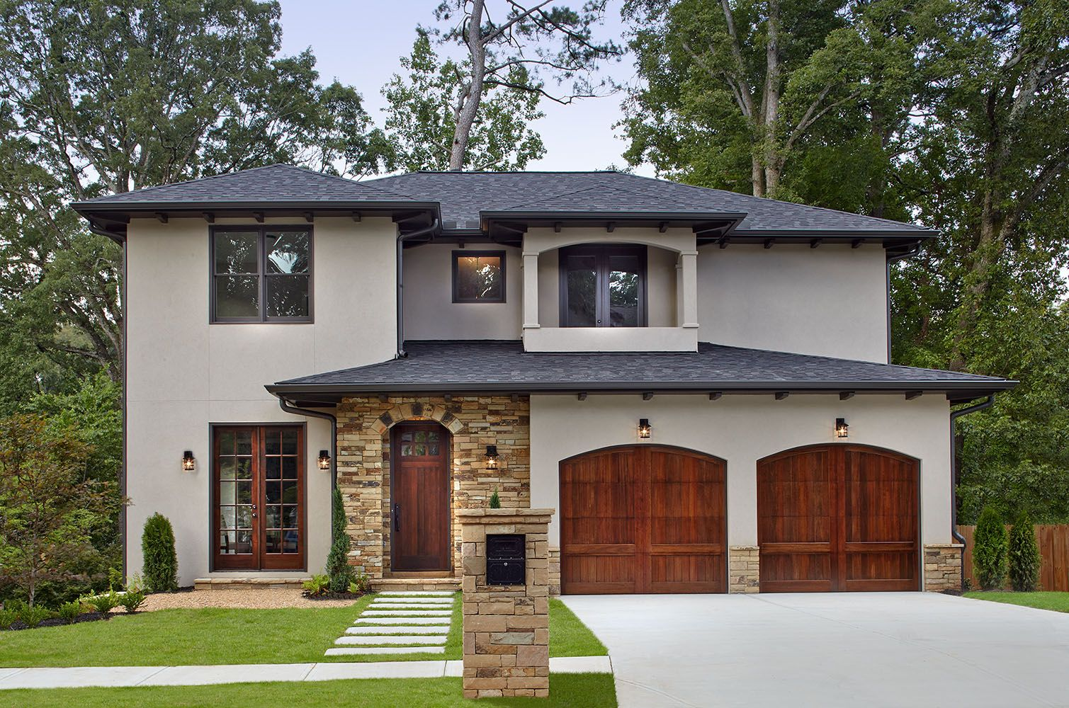 A New Mediterranean Inspired Home In Atlanta S Virginia Highland Neighborhood The Exterior Is Hard Coat Stucc Carriage House Doors House Exterior Stucco Homes