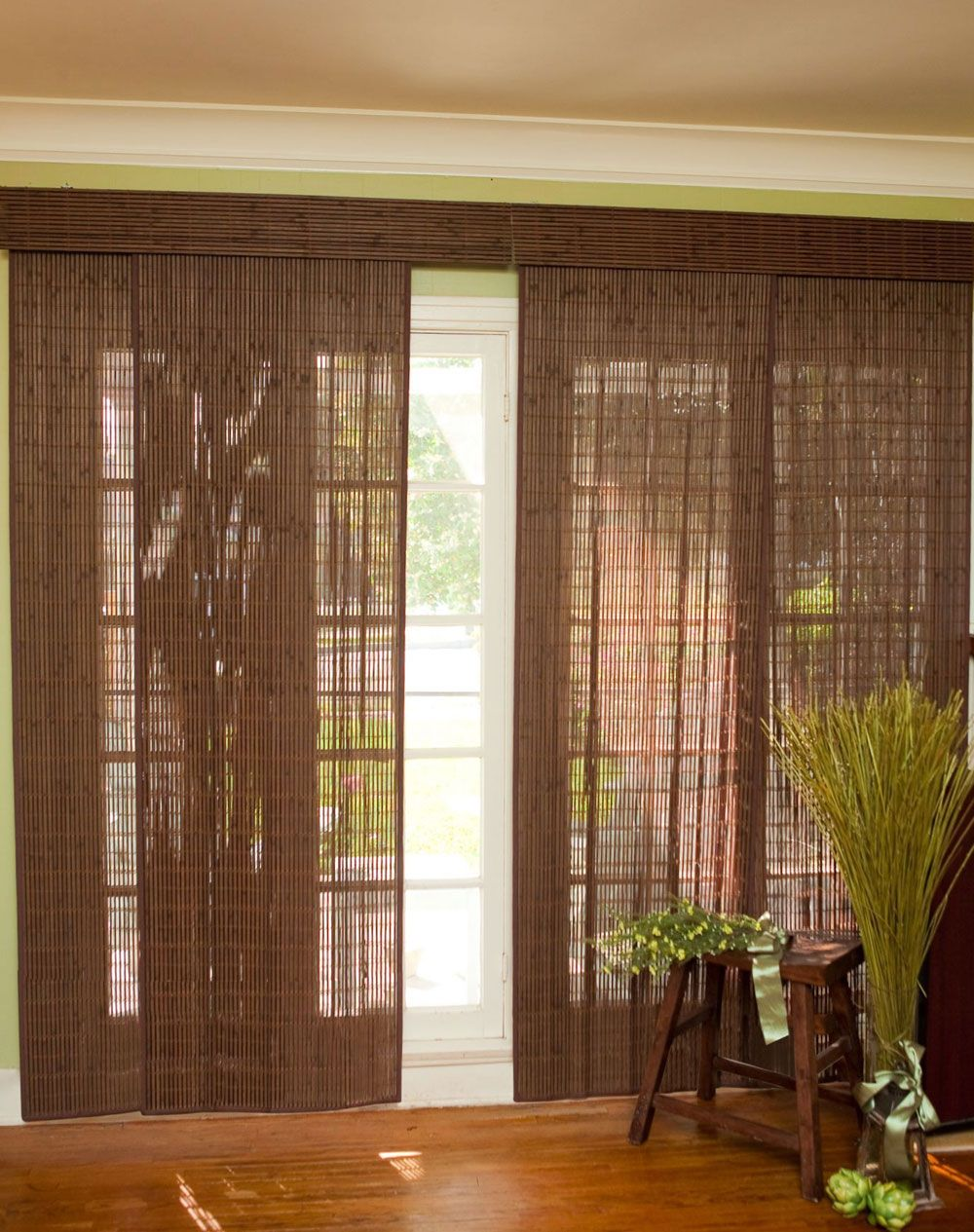 Blinds for sliding glass doors with decorative plant and chair