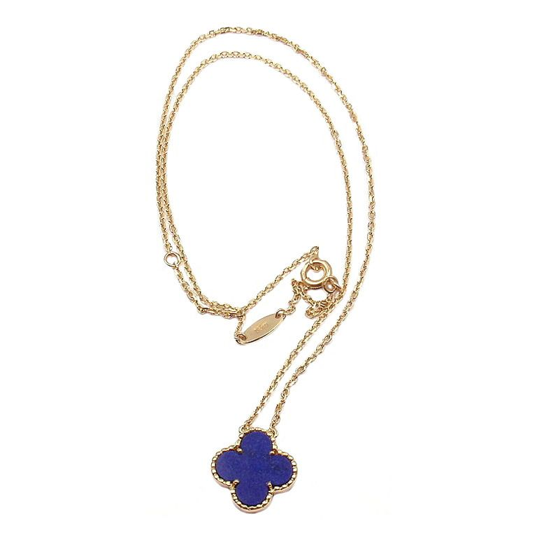 Van Cleef & Arpels Lapis Lazuli Yellow Gold Alhambra Motif Necklace | From a unique collection of vintage drop necklaces at http://www.1stdibs.com/jewelry/necklaces/drop-necklaces/