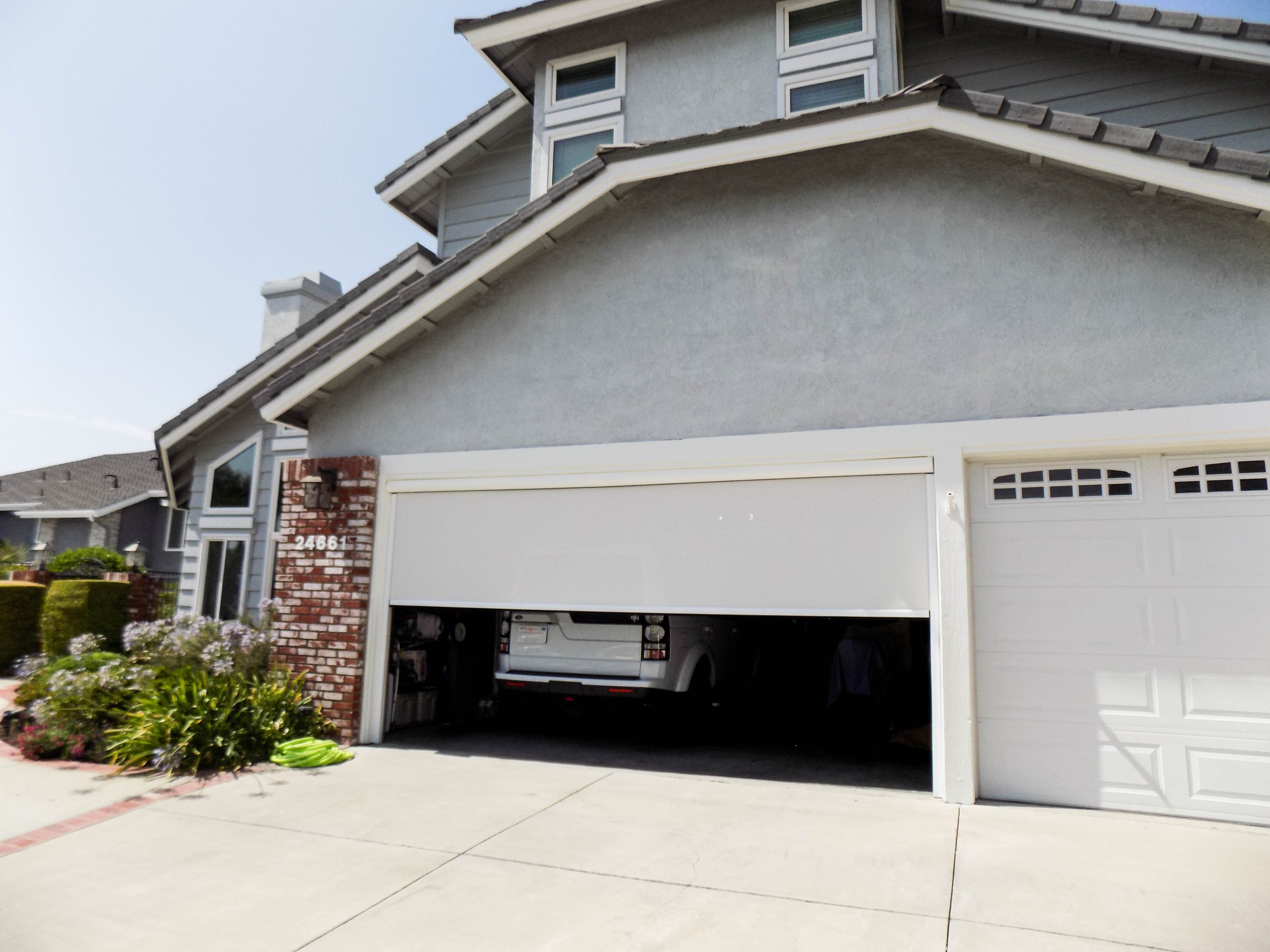 We Installed A Motorized Power Screen On A Garage Door In Laguna Hills California In Orange County For This Traditional Style Homes Garage Doors Garage House