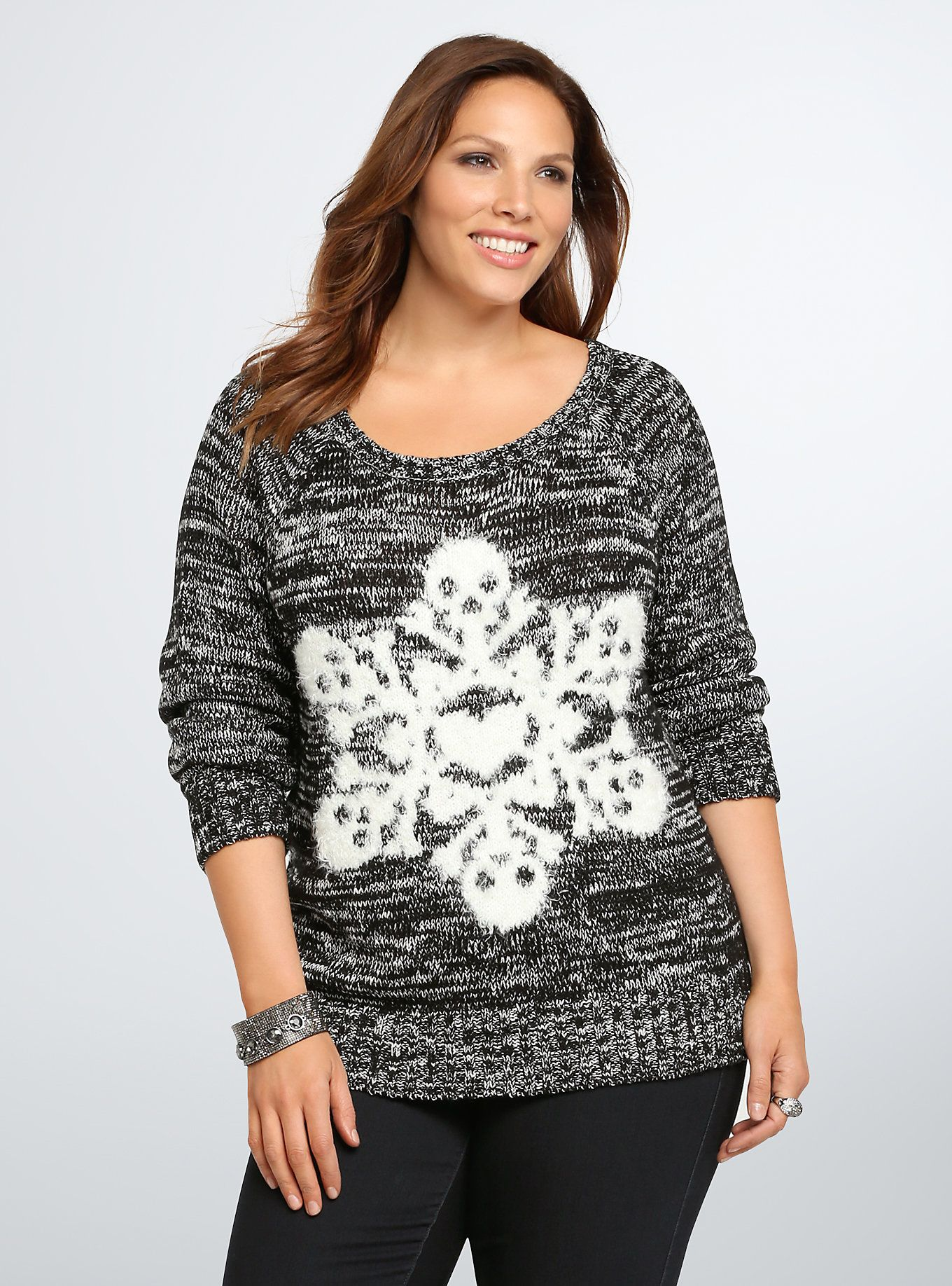 "<p>With this sweater, we can't wait for a snow day! The ""lounge by the fire"" black and white marled knit is super cozy, while a white fuzzy snowflake graphic gets a subtle punk touch with skull and heart graphics. Let it snow already!</p>  <p> </p>  <p><b>Model is 5'9.5"", size 1</b></p>  <ul> 	<li>Size 1 measures 29 1/2"" from shoulder</li> 	<li>Acrylic/polyester</li> 	<li>Wash cold, dry flat</li> 	<li>Imported plus size sweater</li> </ul>"