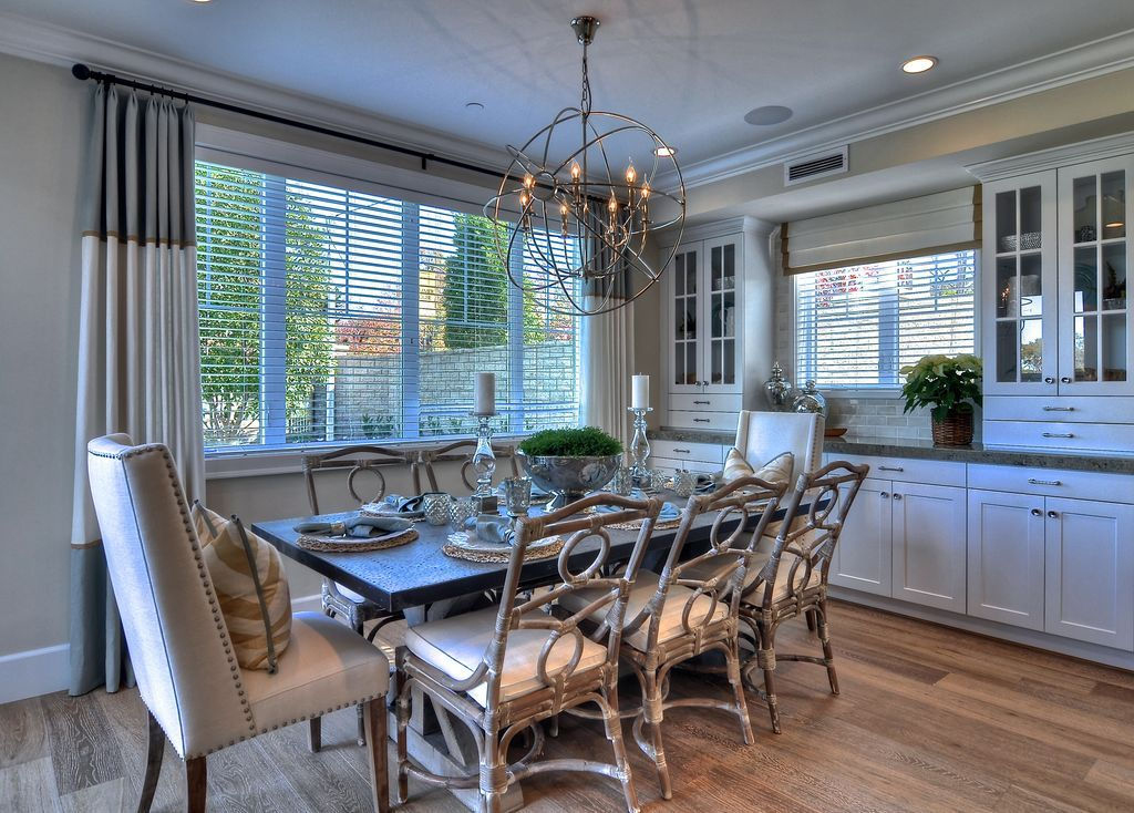 Contemporary Dining Room with Foucaults Orb Chandelier