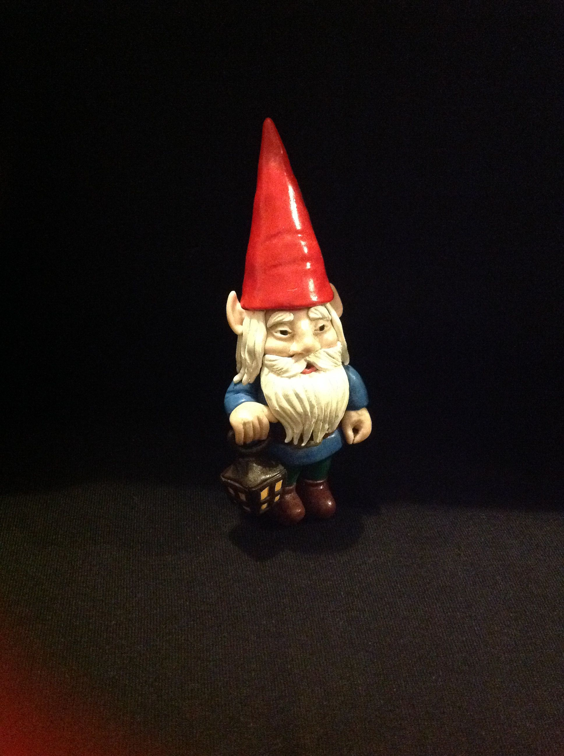 Polymer clay garden gnome. I don't have a garden so I made him pot plant size