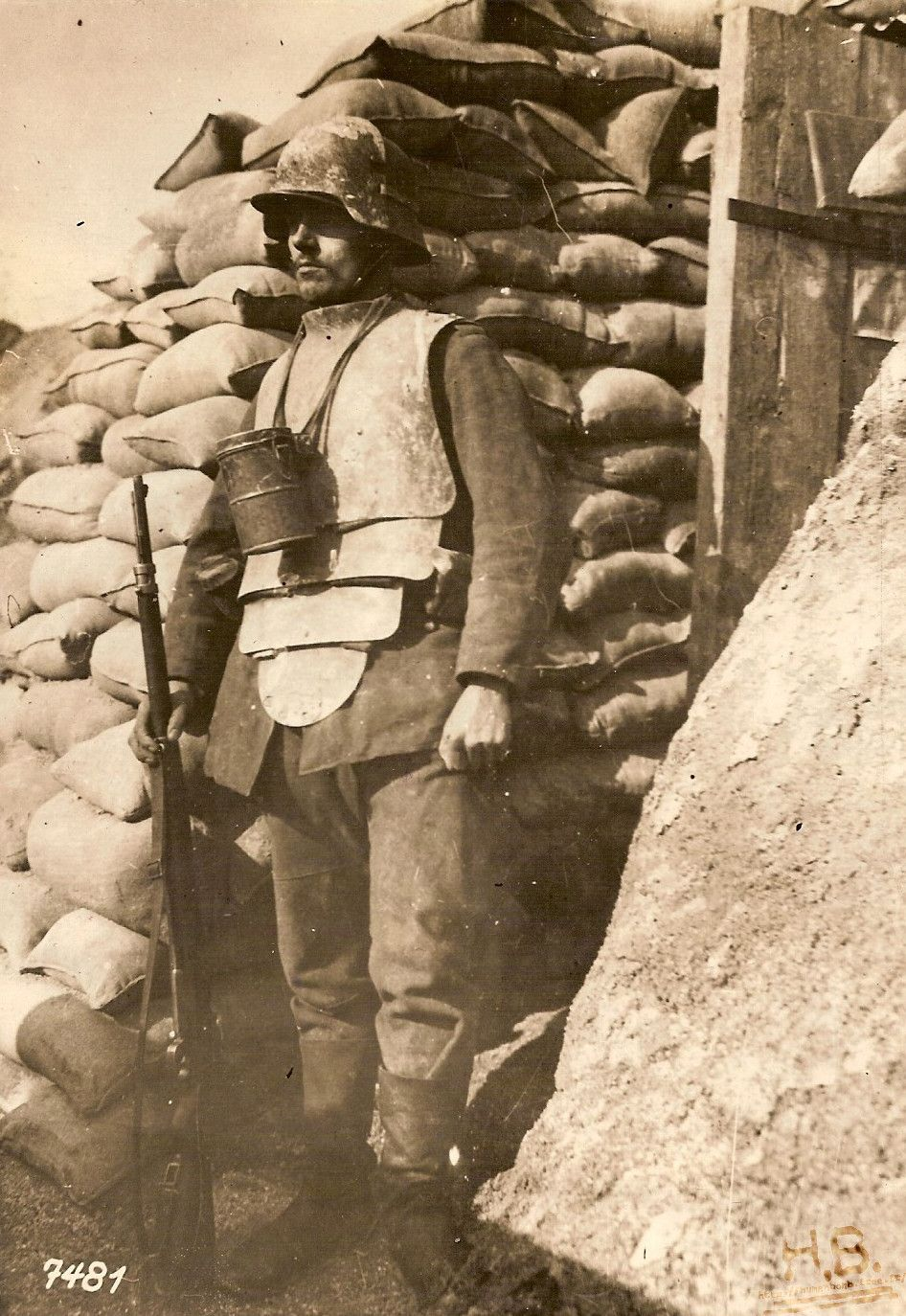 A German soldier wearing infanterie-panzer armor on the Western Front, 1918. Notice the added front plate on the helmet designed to protect from snipers. The canister hung around his neck contains his gas mask. [946x1374]