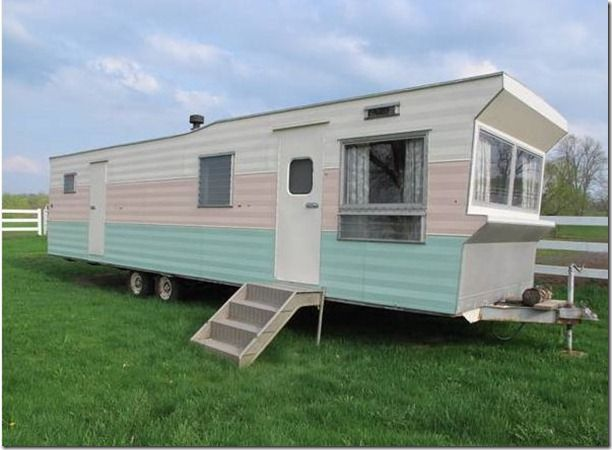 An Aqua And Pink Vintage 1960 Rollohome Park Model Trailer