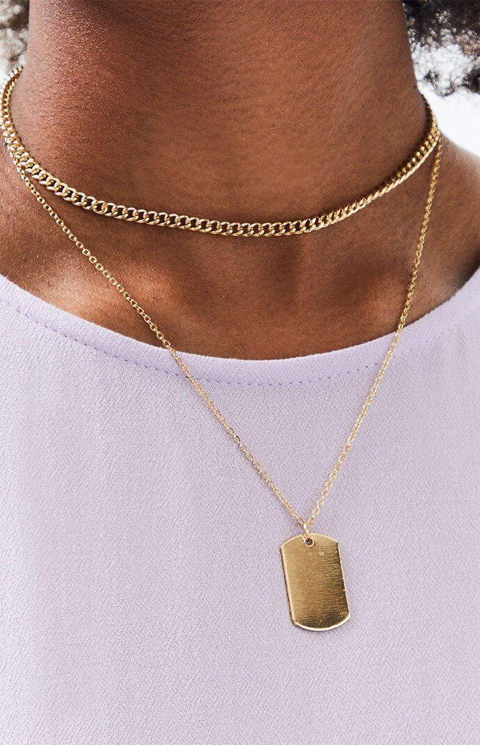 "Freshen up your everyday look with the Dog Tag Necklace from our very own LA Hearts. This layered necklace is complete with a dog tag charm and a gold-finish.      	Includes 1 necklace  	12"" length / 3"" extender  	Lobster clasp closure  	Dog tag charm  	Gold-finish"