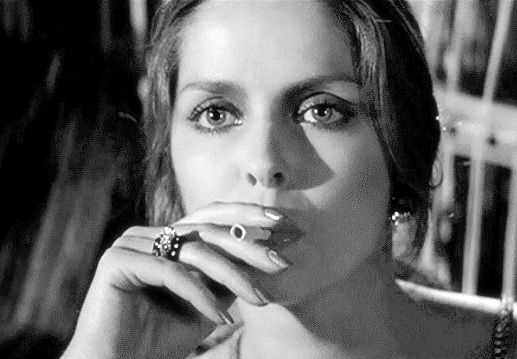 Barbara Bach smoking a cigarette (or weed)