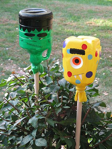 Halloween Monster Yard Lights - Made of milk jugs, old broom handle - halloween milk jug decorations