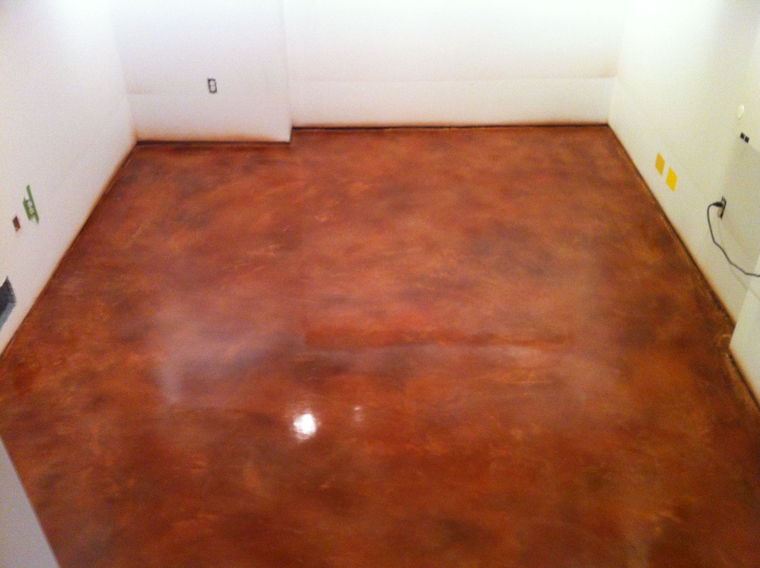 Stained concrete is perfect for a laundry room, basement, or even a bedroom!