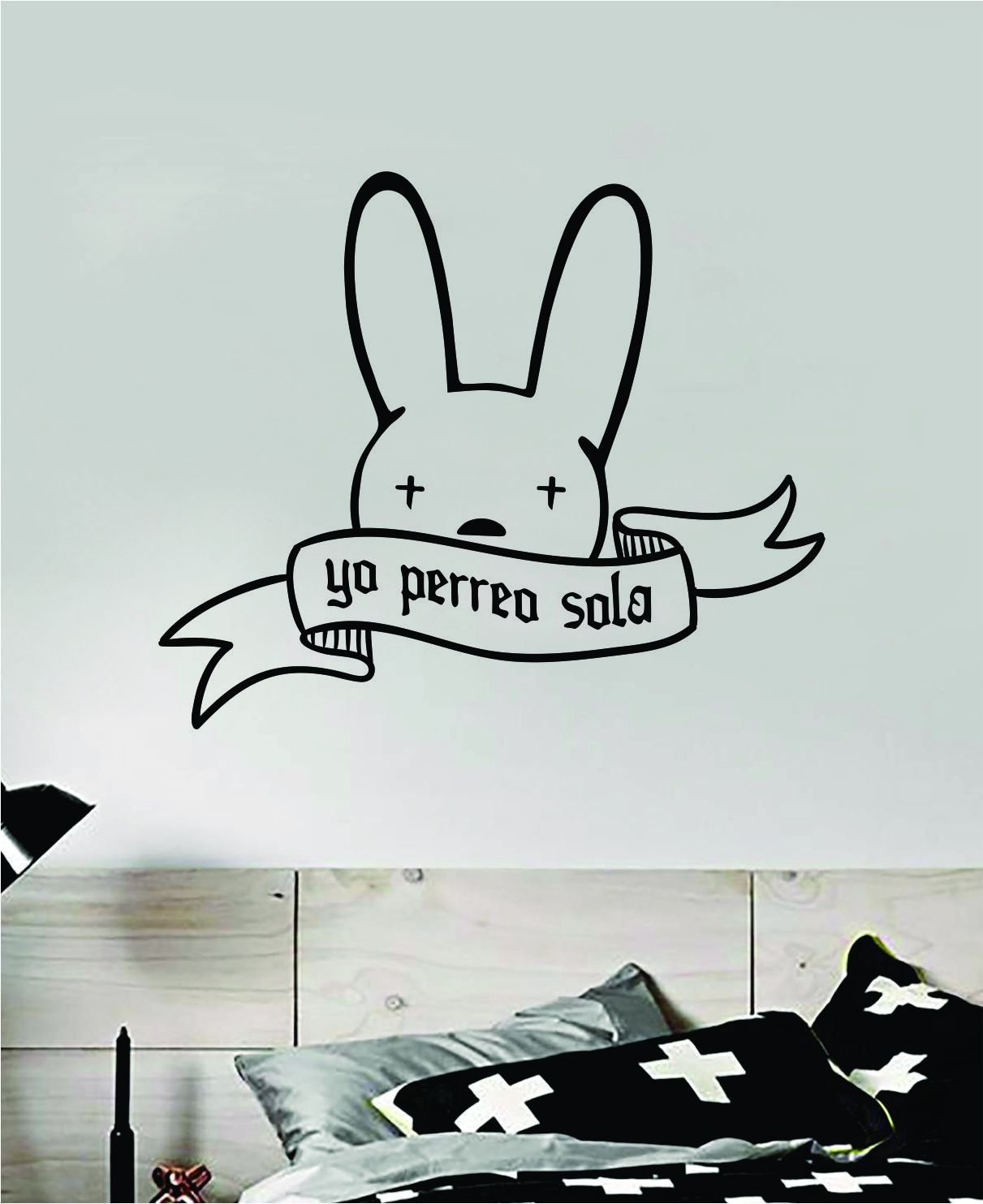 """Yo Perreo Sola Bad BunnyThe latest in home decorating. Beautiful wall vinyl decals, that are simple to apply, are a great accent piece for any room, come in an array of colors, and are a cheap alternative to a custom paint job.Default color is black MEASUREMENTS:28"""" x 23.5"""" About Our Wall Decals: * Each decal is made of high quality, self-adhesive and waterproof vinyl.* Our vinyl is rated to last 7 years outdoors and even longer indoors.* Decals can be applied to any clean, smooth and flat surfa"""