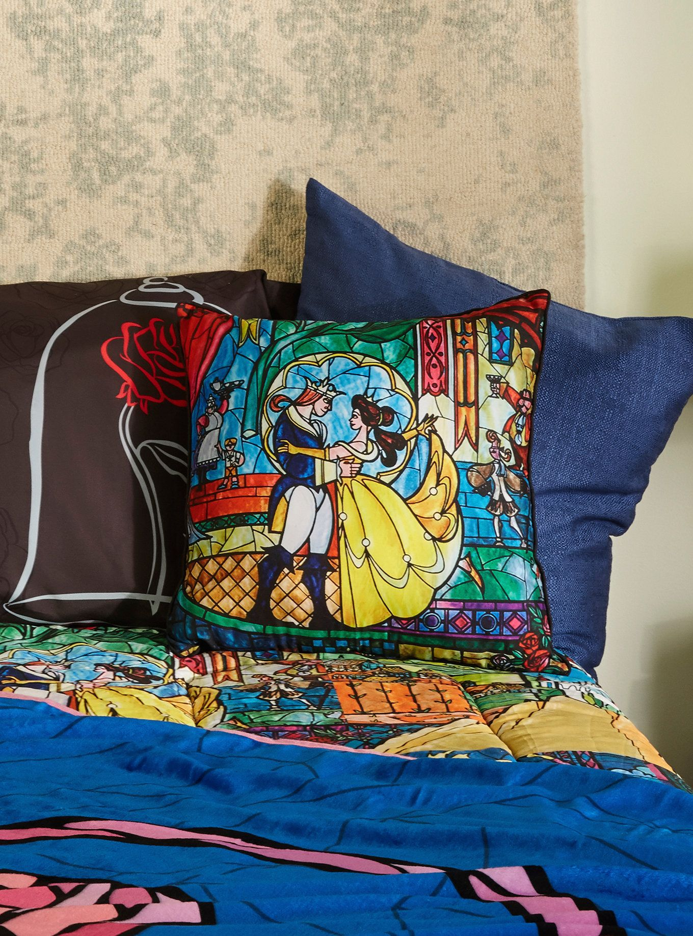 add some color to your castle decor with this square throw pillow from disneys beauty and the beast pillow features a stained glass style design of belle