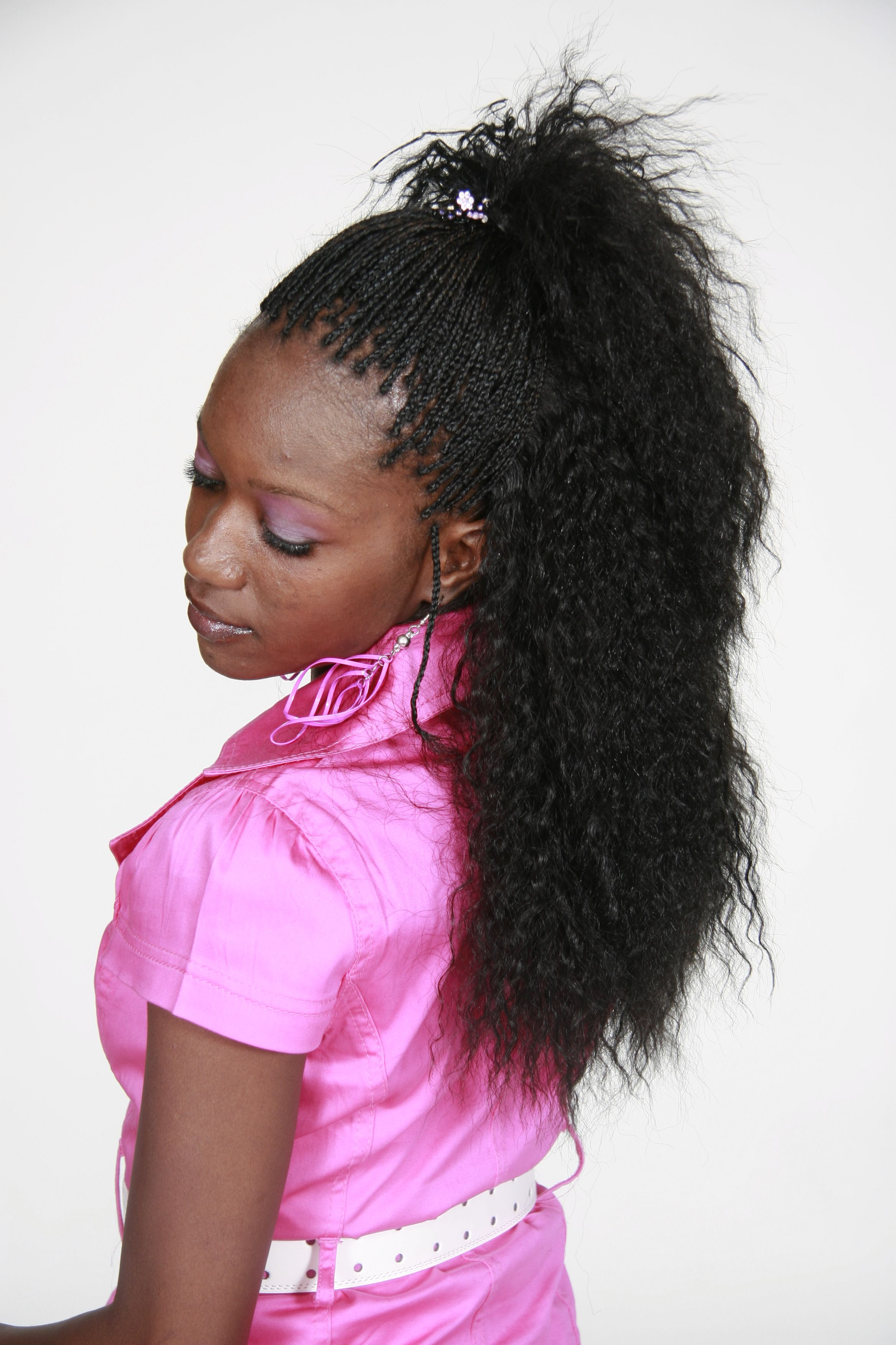 this style is called a semi-zillion which is braids around the