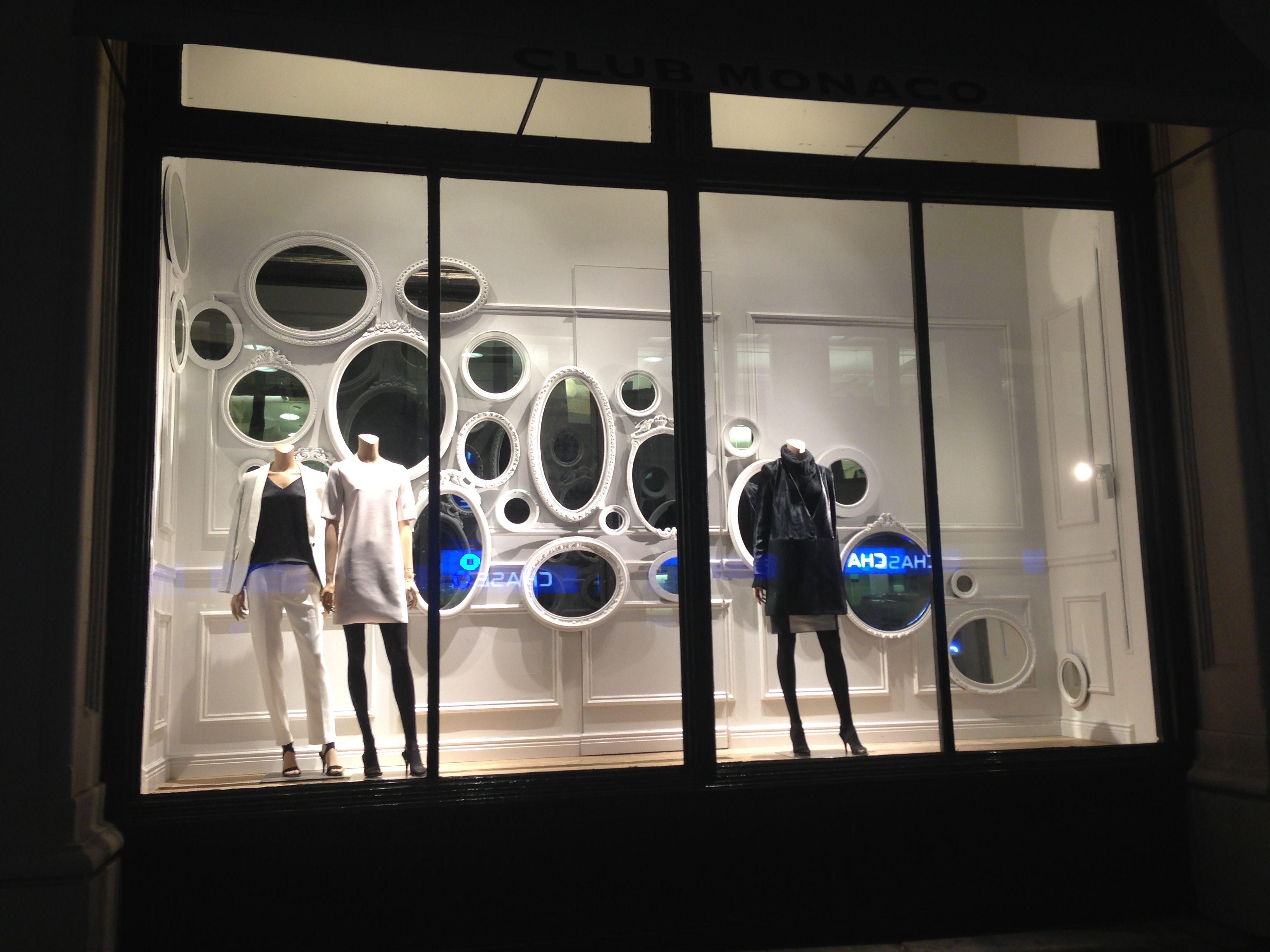 Beautiful monochromatic retail window display club Monaco NYC - mirror wall