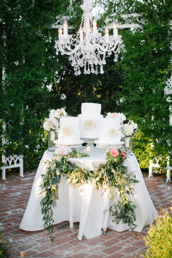Cake table with greenery cake table cake and photography for Outdoor wedding table decorations
