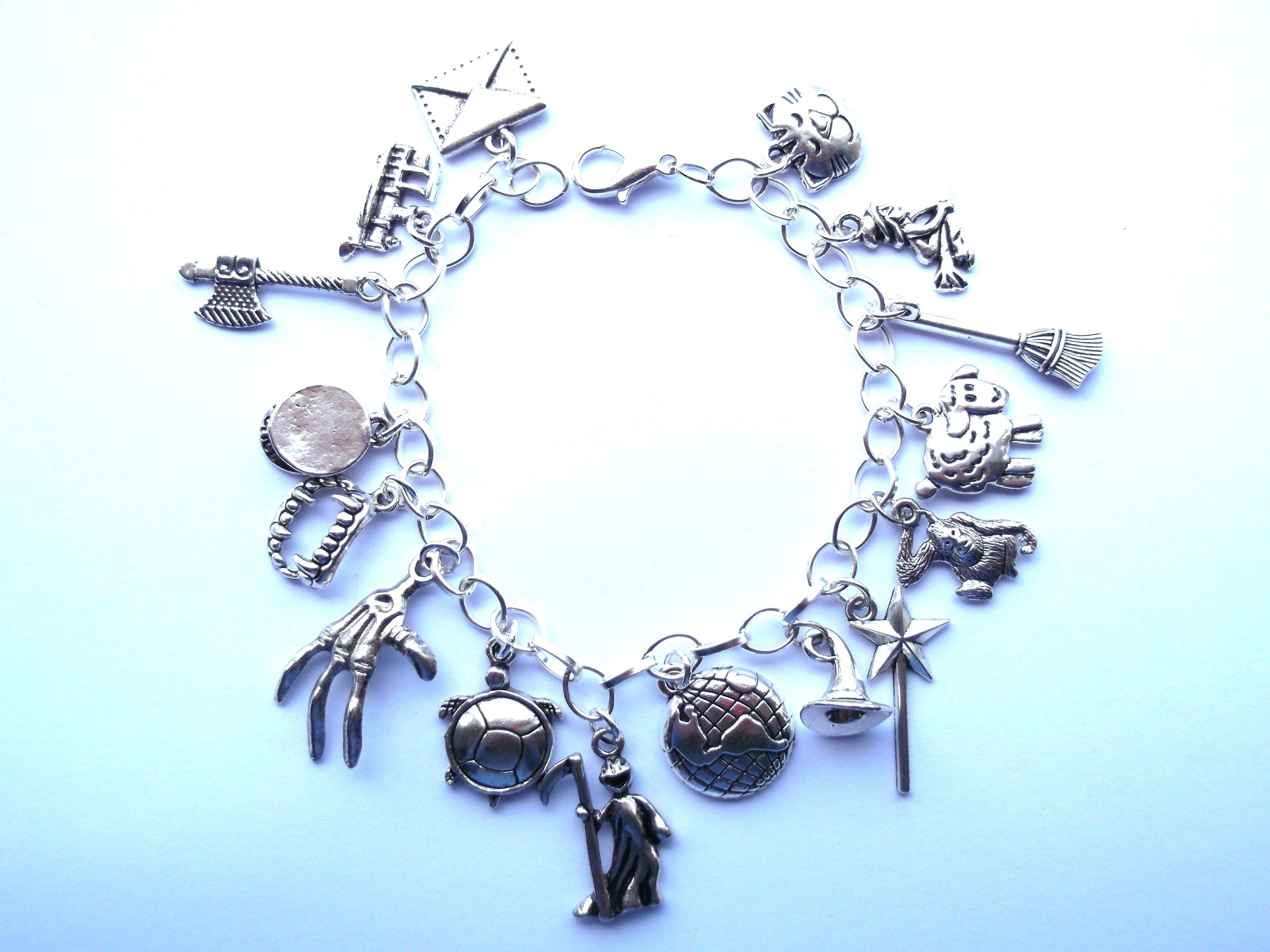 TV Inspired GOT Charm Bracelet with Amber Colored Beads