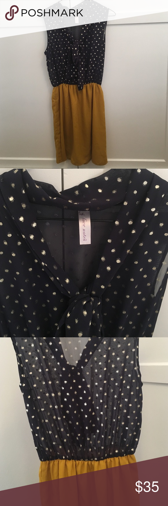 Bow top fall dress Blue and burnt yellow dress - top is sheer with gold polka dots as a cute tie  at the neck, skirt is lined. Worn two or three times. Super cute paired with a belt. Francesca's Collections Dresses