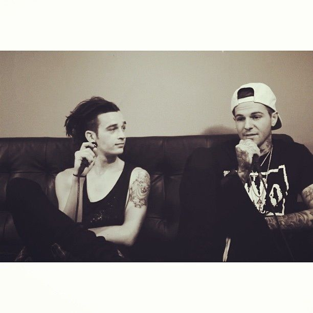 Matt from the 1975 (wearing muscle tee) and Jesse from the neighbourhood
