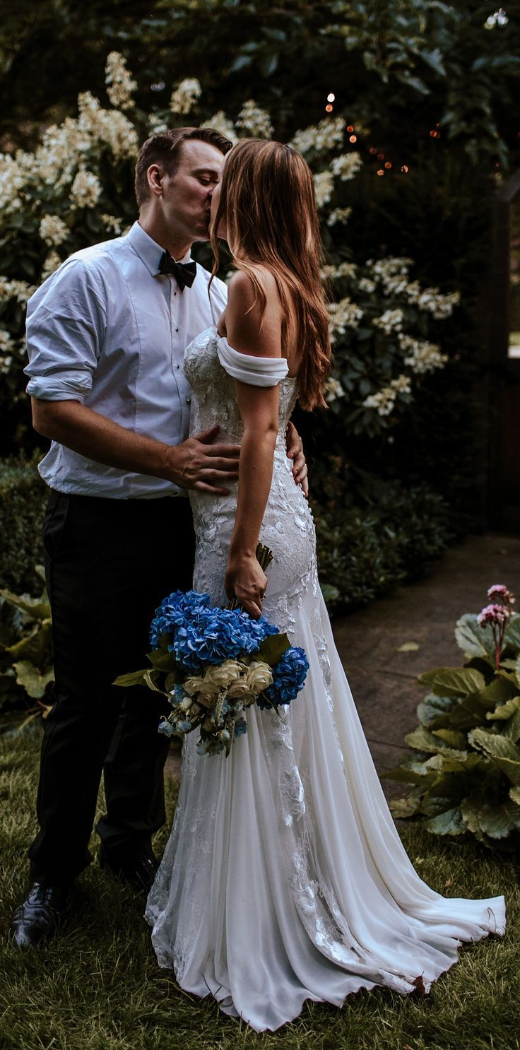 Wedding dress sleeve off the shoulder beautiful blue bouquet with