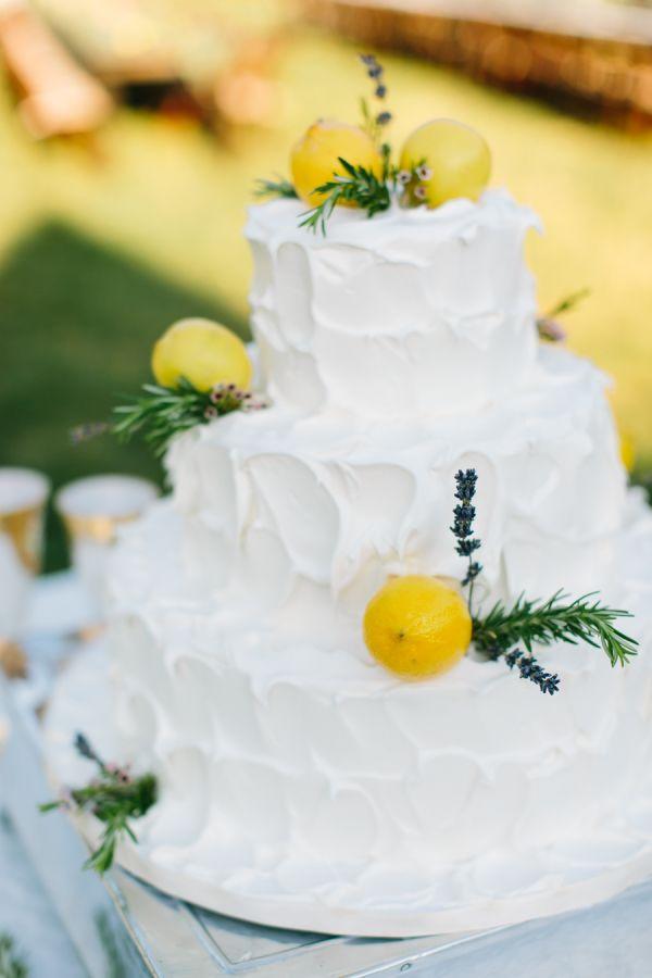 Spring lemon topped wedding cake: http://www.stylemepretty.com/2017/04/27/spring-al-fresco-wedding/ Photography: Rachel Moore - http://www.rachelmoorephoto.com/