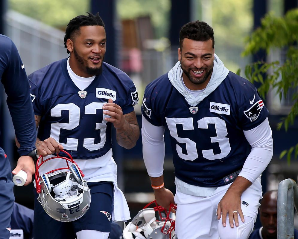 b6306e8621e Patrick Chung and Kyle Van Noy head for the field for New England Patriots  training camp at Gillette Stadium in Foxboro on Thursday