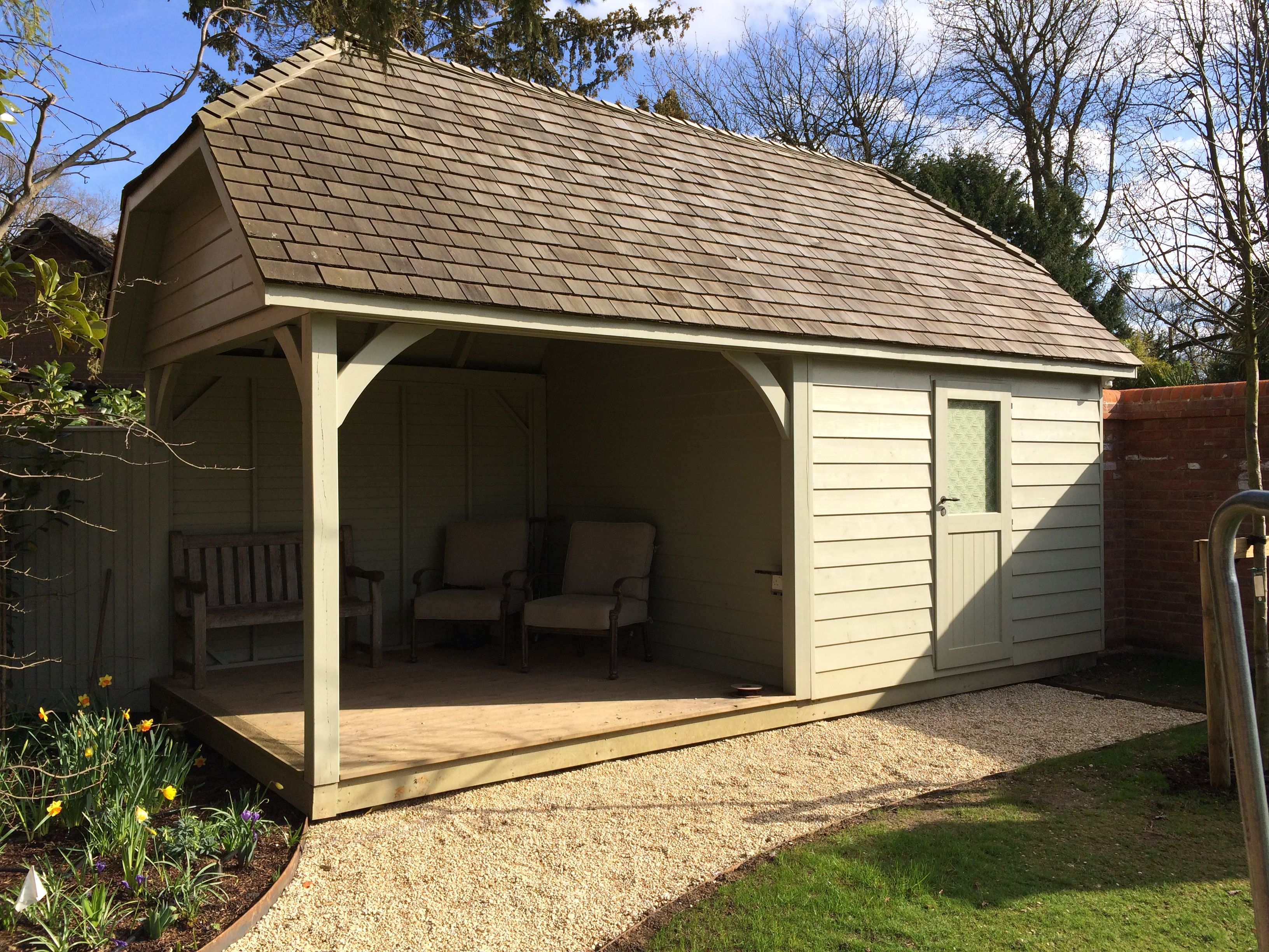 Garden Shed with integral seating, hipped roof. By Garden