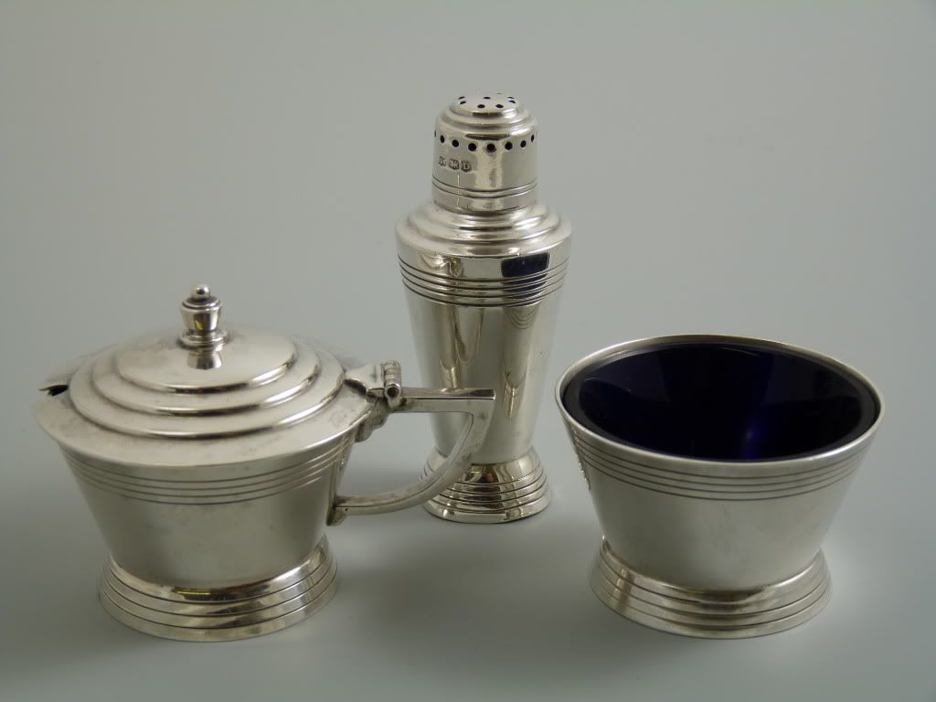 Solid Silver Salt, Pepper and Mustard. Made by Mappin and Webb to a design attributed to Keith Murray. This example is hallmarked for Sheffield 1946. Examples in Silver plate also carry an Rd. No. 772183 which dates between 1932 and 1933. Have now seen set Hallmarked Sheffield 1933 which also has the Rd. No 772183.