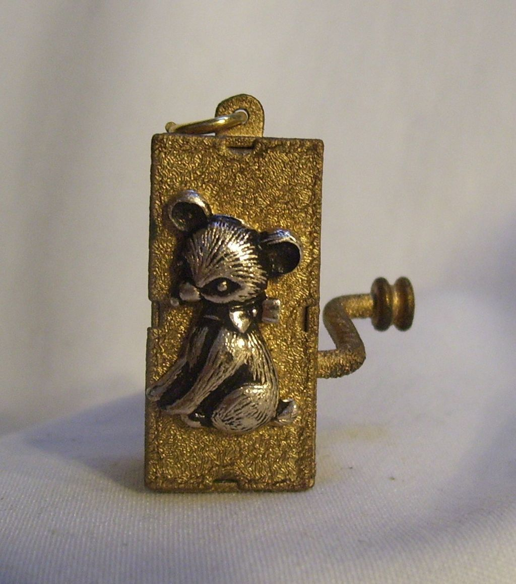 Vintage miniature crank wind music box pendant with a bear tiny vintage miniature crank wind music box pendant with a bear aloadofball Gallery