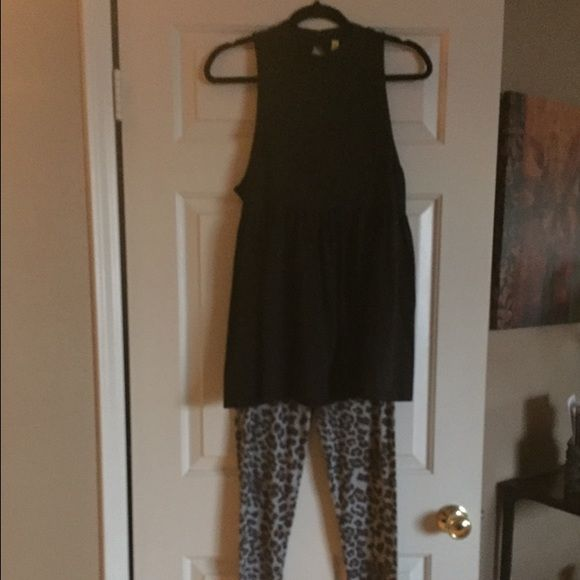 FREE PEOPLE BRAND NEW W/TAGS SUPER CUTE TOP BLACK Free People Brand New With Tags Size Small Black Color summer Top. Leggings shown in photo super cute cheetah print Blueish with Black and Tan are a gift with purchase of top, size small med! Free People Tops Tank Tops