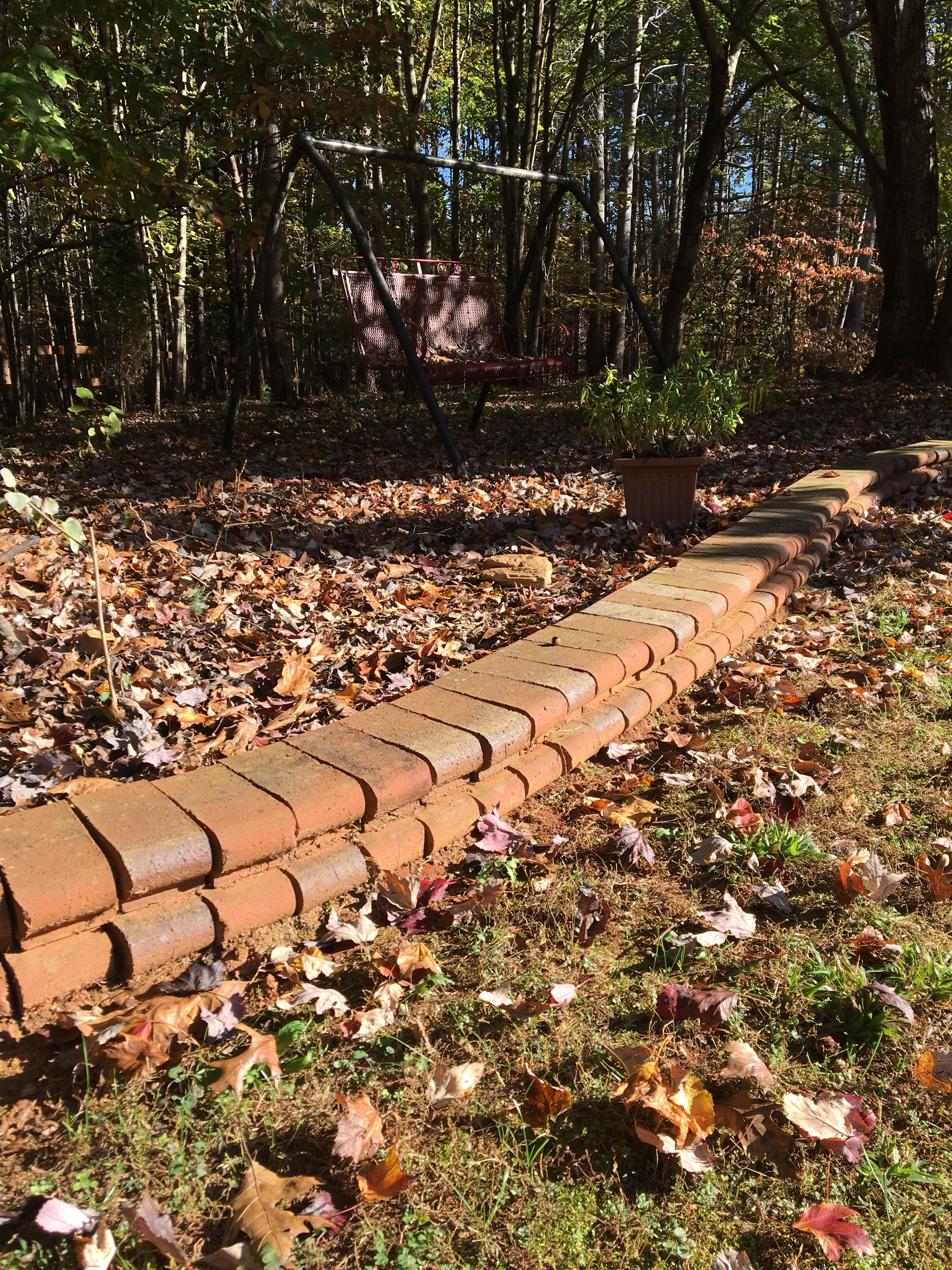 Novel garden wall idea! Use brick architectural shapes (in this case ...