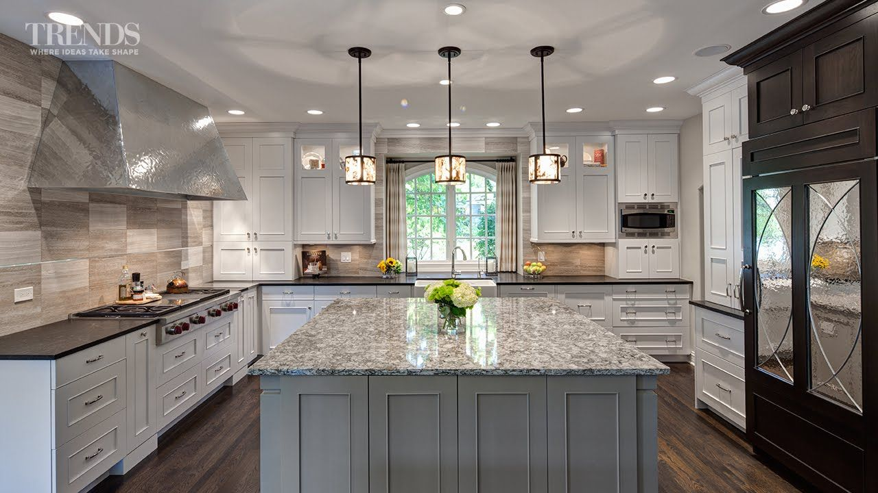 Large transitional kitchen design has two islands