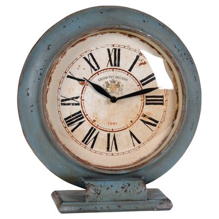 Weathered metal table clock in aqua with Roman numerals.   Product: Table clockConstruction Material: Metal and glas...